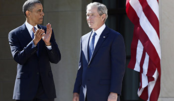 President Barack Obama stands with former president George W. Bush