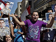 Families of missing soldiers who were kidnapped by Islamic State militants and the Al-Nusra front, chant slogans as they hold portraits of Lebanese soldier Saif Thebian