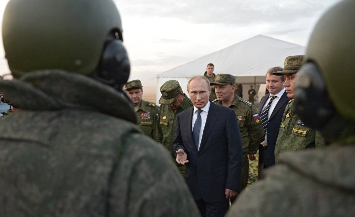 Russian President Vladimir Putin meets with officers after military exercises at Donguz range in Russia