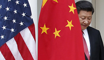 Chinese President Xi Jinping steps out from behind China's flag as he takes his position for his joint news conference with President Barack Obama