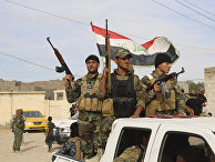 Sunni volunteer fighters parade as they prepare to support Iraqi security forces in liberating the city of Ramadi from Islamic State group militants