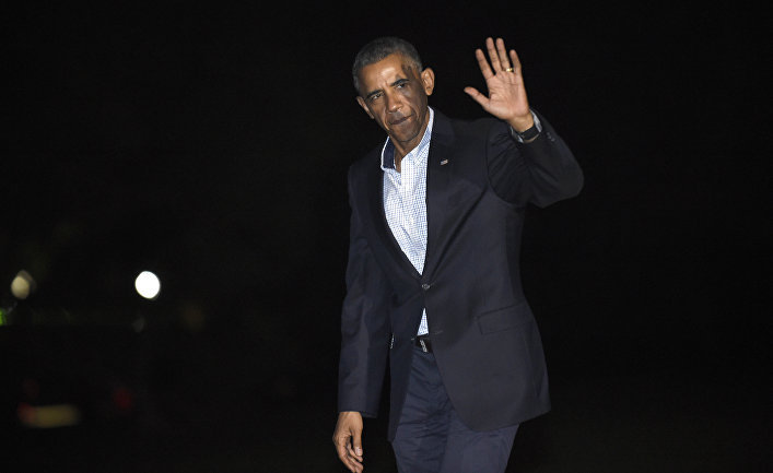 President Barack Obama waves as he walks off of Marine One on the South Lawn of the White House in Washington