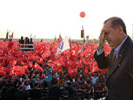 Turkey's President Recep Tayyip Erdogan salutes supporters as tens of thousands of flag-waving demonstrators rally to denounce violence by Kurdish rebels, in Istanbul