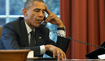 President Barack Obama listens during a phone call at the White House