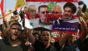 Syrians who live in Lebanon chant slogans during a rally to thank Moscow for its intervention in Syria