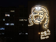 "Some office lights are left on at the Ministry of Interior, decorated with an iron sculpture of Cuba's revolutionary hero Ernesto ""Che"" Guevara at Revolution Square in Havana, Cuba"