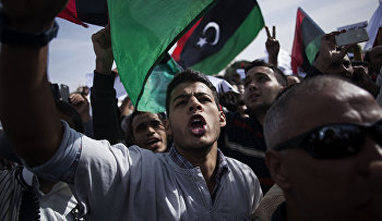 A Libyan man shouts slogans against the Tripoli-based militias and supporting the new national army and the police corps during a protest in the Libyan capital Friday, Nov. 22, 2013.