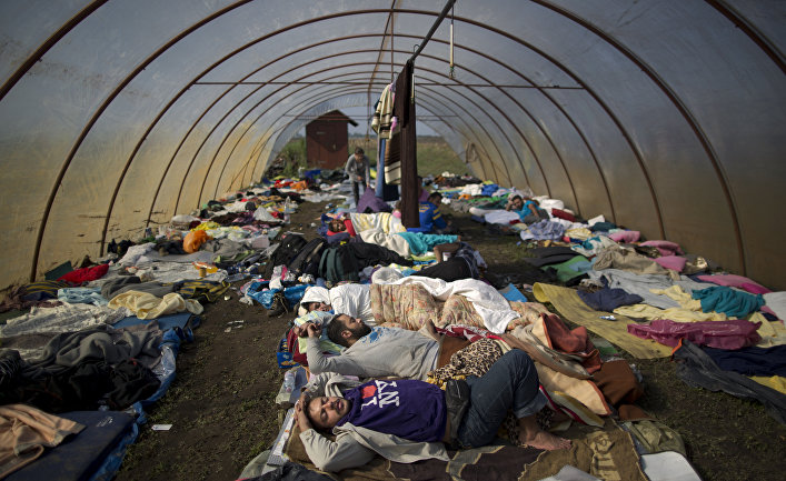 Syrian people sleep inside a greenhouse at a makeshift camp for asylum seekers near Roszke, southern Hungary. Tens of thousands of people trying to escape conflict and poverty in places like Syria and Afghanistan