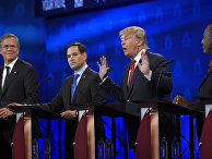 Donald Trump, second from right, speaks as Jeb Bush, left, Marco Rubio, second from left, and Ben Carson look on during the CNBC Republican presidential debate at the University of Colorado