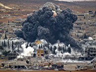 Nov. 17, 2014 file photo, smoke rises from the Syrian city of Kobani, following an airstrike by the U.S.-led coalition