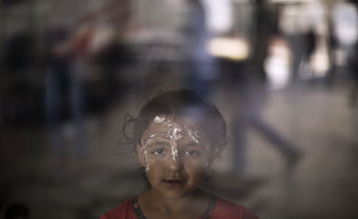 Syrian girl Rahaf Kaddour, 5, who was burnt in an explosion that hit her home, poses for a picture at MSF Hospital for Specialized Reconstructive Surgery in Amman, Jordan