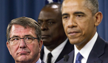 Defense Secretary Ash Carter, left, looks at President Barack Obama as the president speaks to the media after receiving an update from military leaders on the campaign against the Islamic State