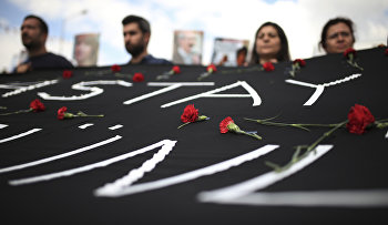 People carry a banner against the bombing attacks in Ankara on Oct. 10, during a protest in Izmir, Turkey