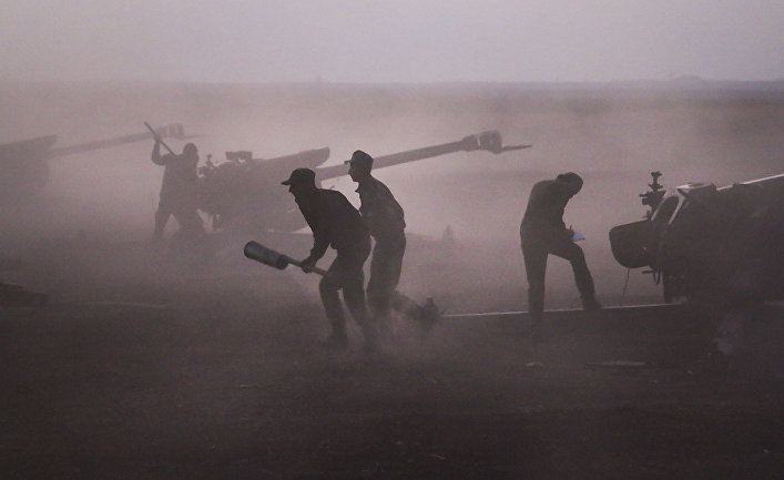 Syrian army personnel load howitzers near the village of Morek, Syria on Wednesday, Oct. 7, 2015.