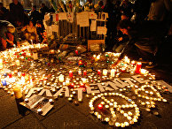 People light candles on a temporary memorial, during a demonstration at the Old-Port, in Marseille, southern France