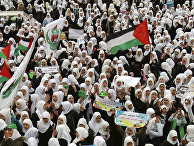 Palestinian students chant slogans during a protest organized by the Islamic Hamas movement in solidarity with the Al-Aqsa Mosque in Jerusalem, at the Palestinian Legislative Council in Gaza City