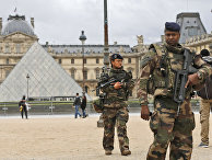 Soldiers patrol in the courtyard of the Louvre Museum in Paris