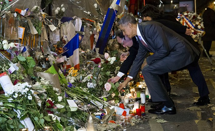 President Barack Obama, right, and French President Francois Hollande place flowers at the Bataclan, site of one of the Paris terrorists attacks, to pay his respects after arriving in town for the COP21 climate change conference