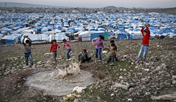 Syrian refugee children play at a temporary refugee camp in Irbil, northern Iraq. Some 240,000 refugees who fled the fighting in Syria now live in Iraq