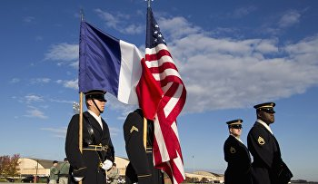 Army honor guards wait for the arrival of French President François Holland at Andrews Air Force Base, Md
