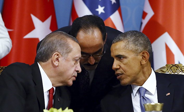 Turkish President Recep Tayyip Erdogan, left, talks with U.S. President Barack Obama, right, during a session of the G-20 Summit in Antalya, Turkey