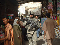 U.S. Army Staff Sgt. Kevin Nettnin conducts a dismounted patrol to assess the progress of security measures in the Al Dora market area of Baghdad, Iraq