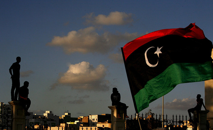 Libyans watch the protest against Ansar al-Shariah Brigades and other Islamic militias, in Benghazi, Libya