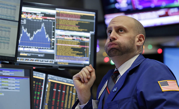 Specialist Meric Greenbaum works at his post on the floor of the New York Stock Exchange, Friday, Dec. 11, 2015
