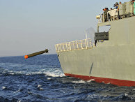 The Iranian Jamaran destroyer launches a torpedo during a maneuver in the Oman Sea in a part of Iranian southern waters.