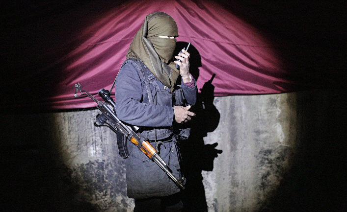 A militant of the Kurdistan Workers' Party, or PKK, stands at a barricade in Sirnak, Turkey, late Wednesday, Dec. 23, 2015. Security forces have killed 183 Kurdish rebels in a week in southeast Turkey