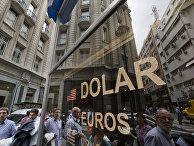 People walk outside a money exchange house in Buenos Aires, Argentina