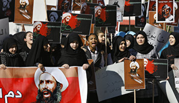 Lebanese students carry portraits of Shiite cleric Sheikh Nimr al-Nimr, a prominent opposition Saudi Shiite cleric who was executed by Saudi Arabia