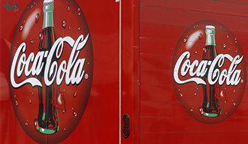 A Coke truck delivers Coca Cola at the Farm Progress Show in Decatur, Ill