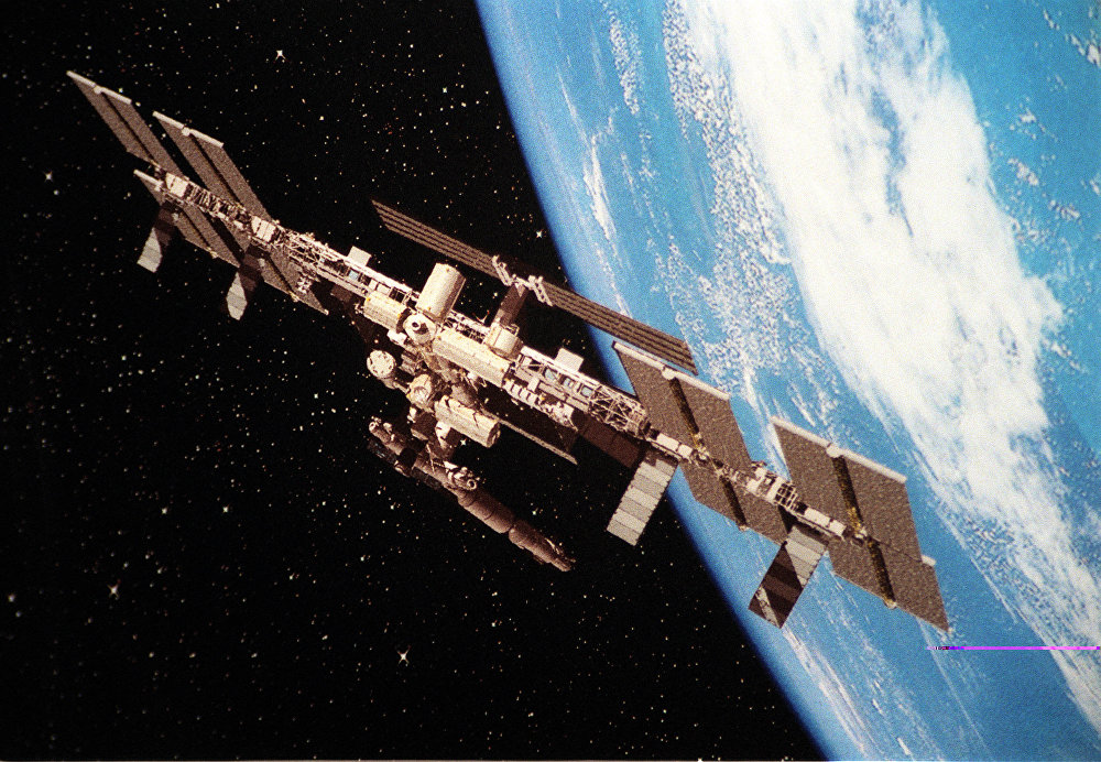 Iss extends operations real costs and risks science for Space station usa