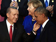 President Barack Obama, right, is greeted by Turkish President Recep Tayyip Erdogan as German Chancellor Angela Merkel is seen in background, after posing for a family photo at the G-20 summit in Antalya, Turkey