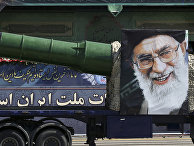 A portrait of the Iranian supreme leader Ayatollah Ali Khamenei is placed on a truck with a military hardware driven in a parade marking the 35th anniversary of Iraq's 1980 invasion of Iran