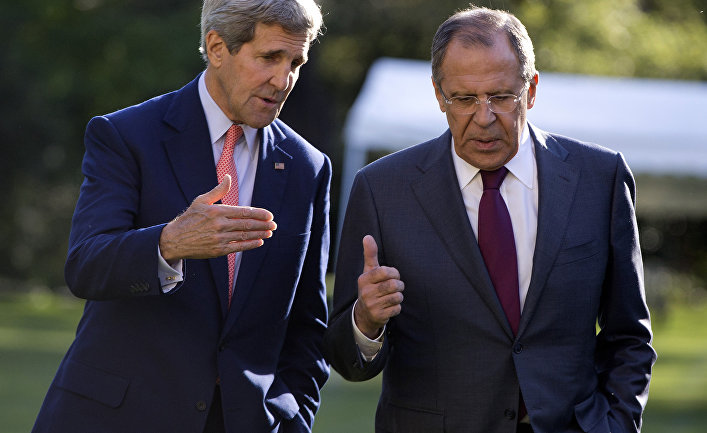 U.S. Secretary of State John Kerry, left, and Russian Foreign Minister Sergey Lavrov talk as they walk together on the grounds of the Chief of Mission Residence in Paris, France, Tuesday, Oct. 14, 2014