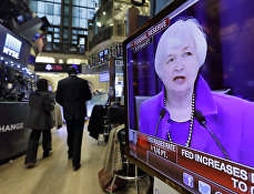 Federal Reserve Chair Janet Yellen's Washington news conference is shown on a television screen on the floor of the New York Stock Exchange, Wednesday, Dec. 16, 2015.
